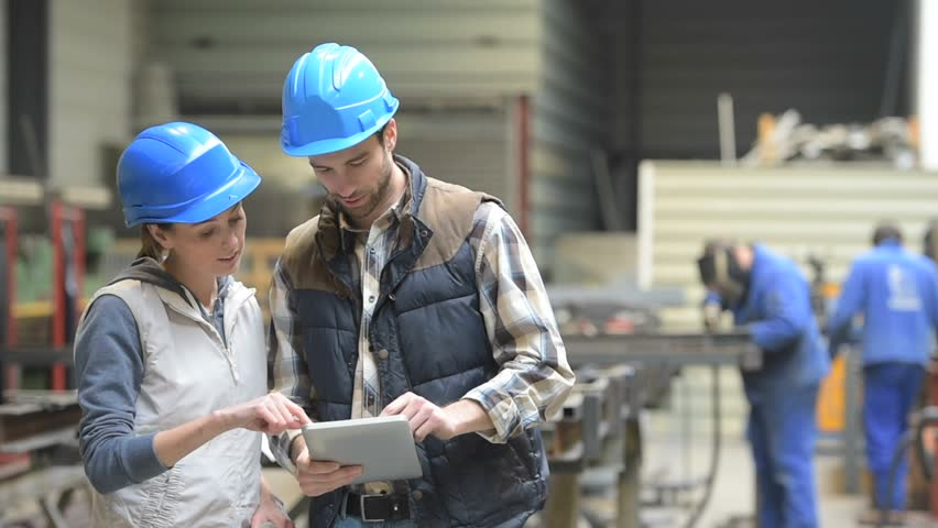 Manager With Mechanical Worker Checking On Production Plans Stock ...