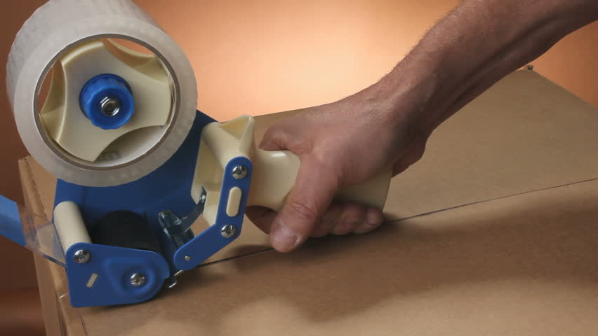 Taping up a box with sealing tape