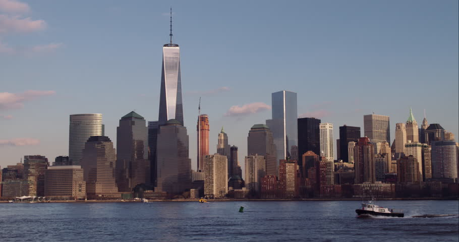 The Downtown Manhattan skyline. A tugboat goes along the Hudson River. | Shutterstock HD Video #9324467