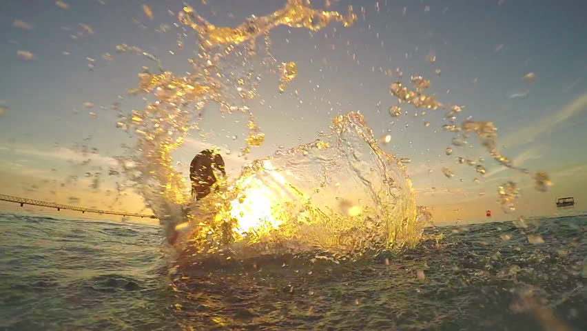 SLOW MOTION: Young woman splashing the water into camera | Shutterstock HD Video #9326384