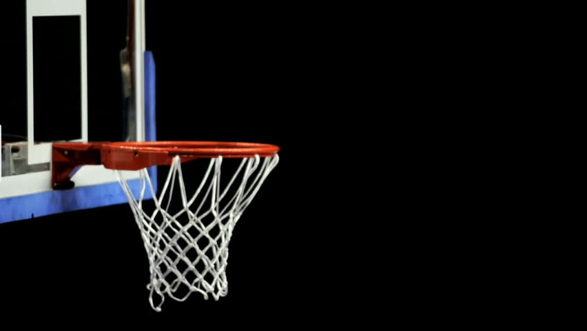 Close up of a basketball falling through the net of the for Making a basketball court