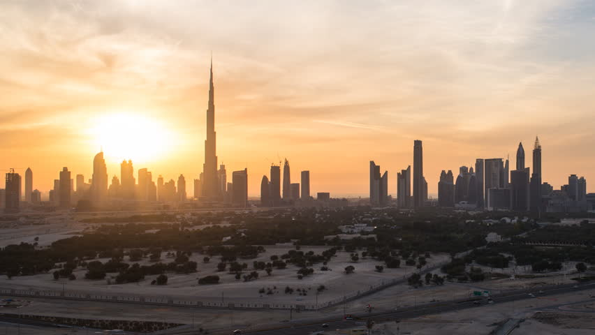 Dubai, United Arab Emirates - CIRCA DECEMBER 2014: Elevated view of the new Dubai skyline, the Burj Khalifa, modern architecture and skyscrapers on Sheikh Zayed Road, time-lapse | Shutterstock HD Video #9547406