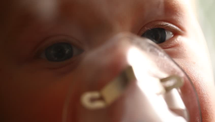 Videos close inhalation child baby boy in the lap of mother | Shutterstock HD Video #9551162