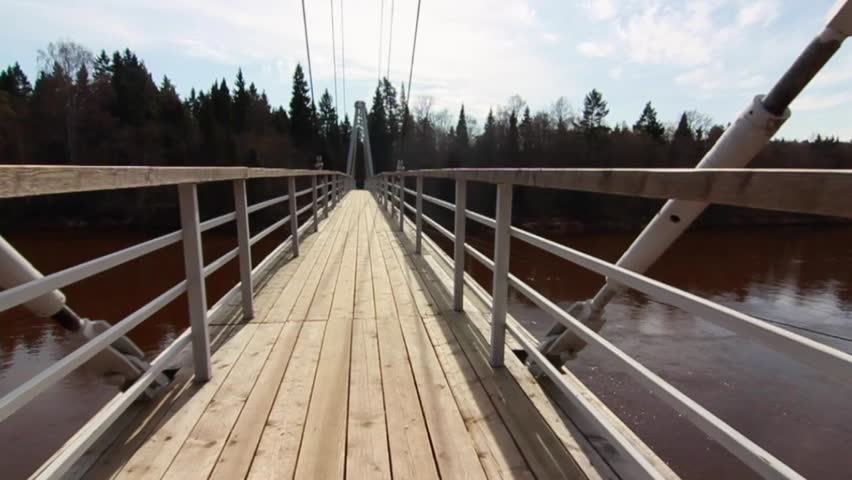 Walking Over The Red River By The Footbridge. Slow motion Version 30sec