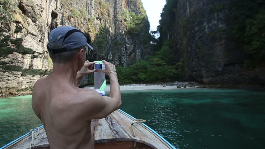 Old Naked Trunk Man Takes Pictures Of Bay Boats Beach