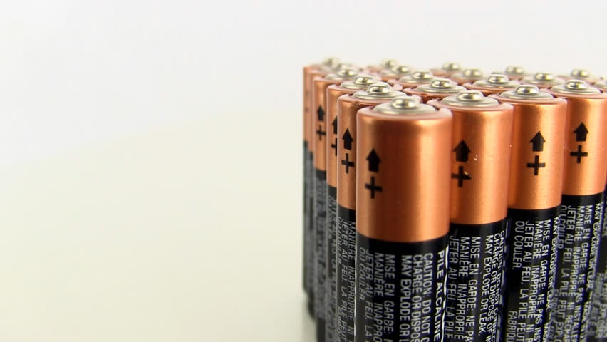 Slow pan from left to right of stack of AA batteries