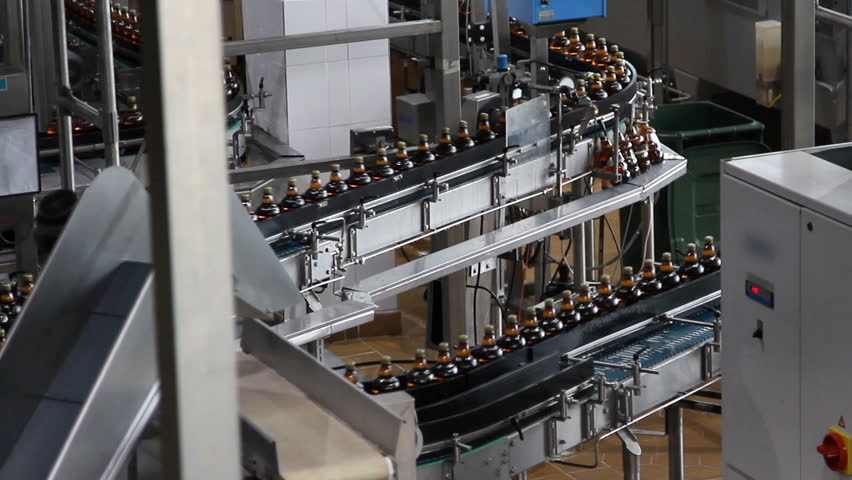 Plastic water bottles on conveyor or water bottling machine  | Shutterstock HD Video #9817139